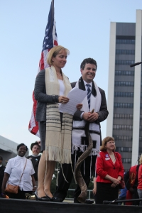 Rabbi Judy and Rabbi Jonathan wake up the crowd with their words and blast of the shofar.